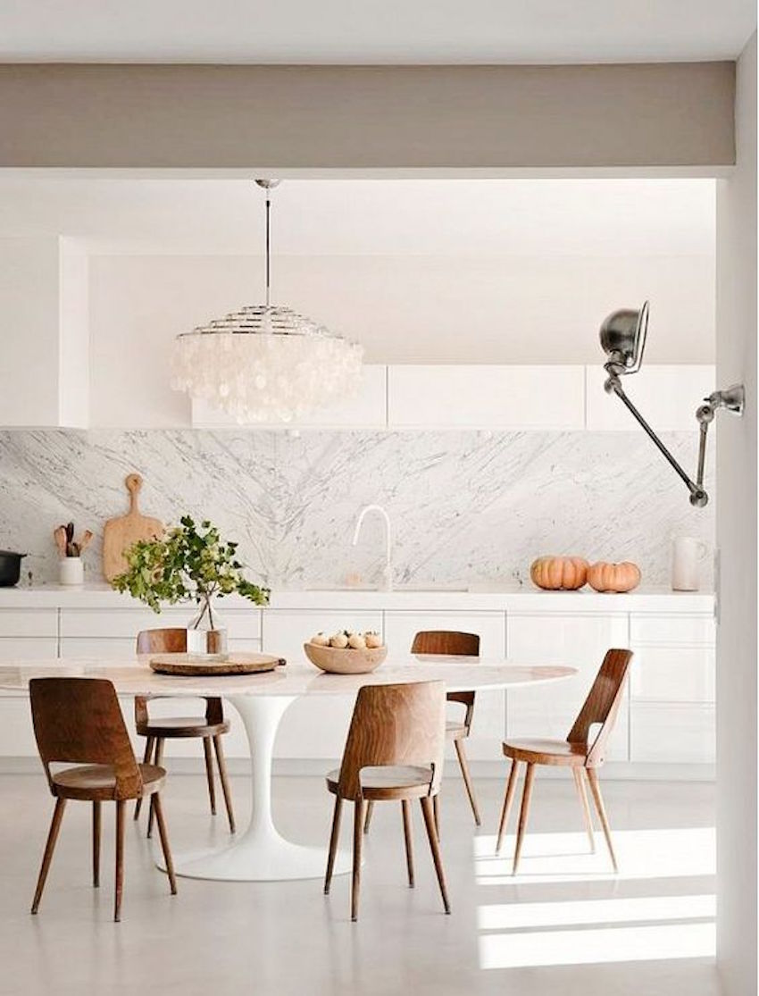 15 astounding oval dining tables for your modern dining room for White kitchen dining chairs