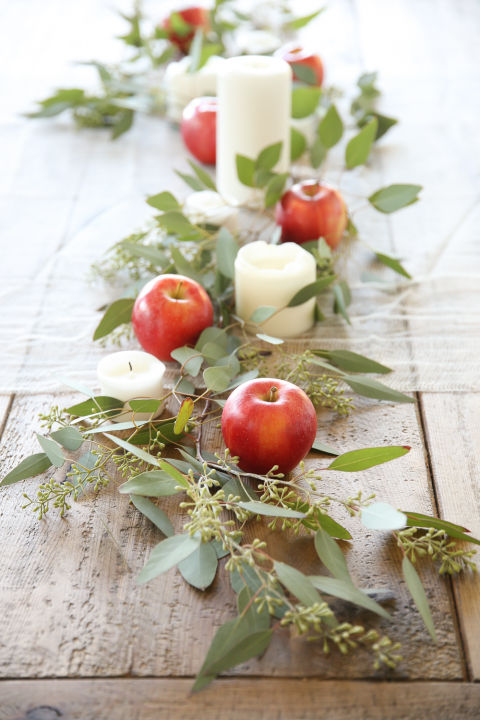 simple-apples-become-sophisticated-when-cushioned-by-seeded-eucalyptus-and-pillar-candles-as-in-this-easy-centerpiece centerpiece 10 Fall Centerpieces for your Dining Room Simple apples become sophisticated when cushioned by seeded eucalyptus and pillar candles as in this easy centerpiece 1 1