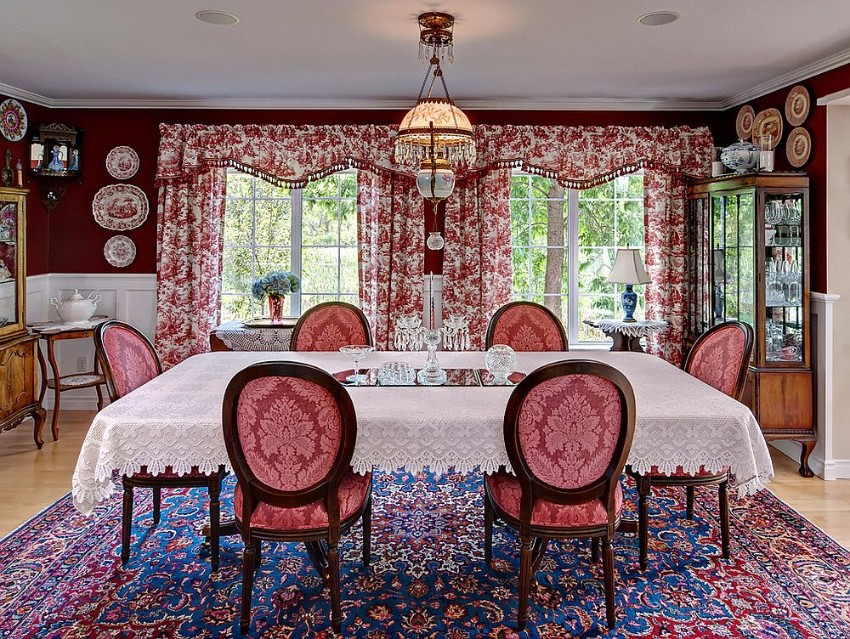 antique-rug-floral-drapes-and-beautiful-red-walls-bring-the-victorian-dining-room-alive victorian 10 Superb Victorian Dining Rooms  Antique rug floral drapes and beautiful red walls bring the Victorian dining room alive