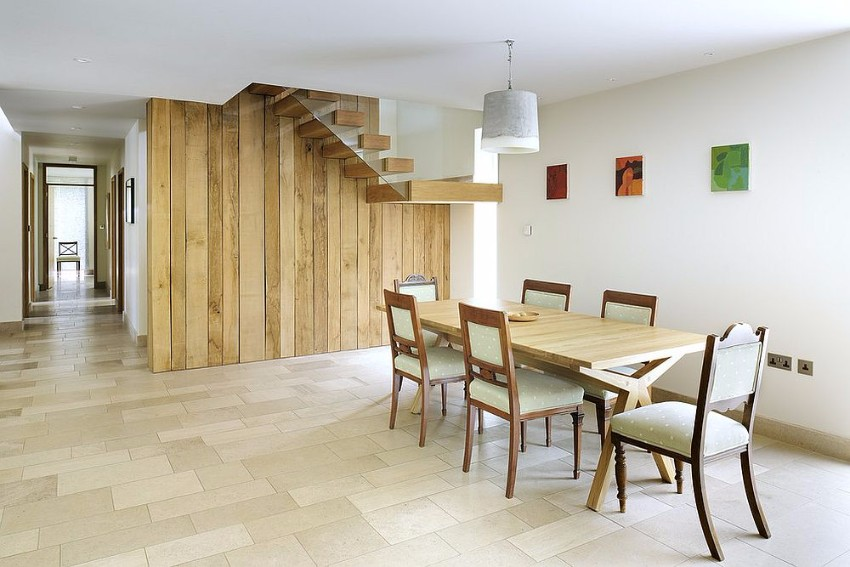 exquisite-reclaimed-wood-wall-with-staircase-becomes-the-backdrop-in-this-dining-room reclaimed wood How to Merge Reclaimed Wood into Your Dining Room Exquisite reclaimed wood wall with staircase becomes the backdrop in this dining room