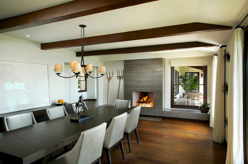 elegant-chandelier-or-black-table-idea-feat-wood-fireplace-insert-and-mid-century-leather-chairs-dining-room