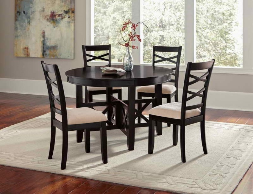 gothic-round-black-dining-table-set-on-neutral-cream-oriental-rug-designed-in-front-of-french-window-idea rug Rugs That Will Improve Your Dining Room Experience gothic round black dining table set on neutral cream oriental rug designed in front of french window idea
