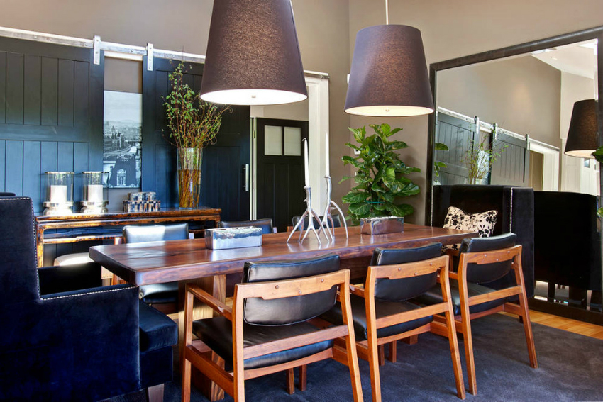large-black-area-rug-idea-plus-mid-century-dining-chairs-feat-huge-pendant-lights-design-and-oversized-wall-mirror-decor