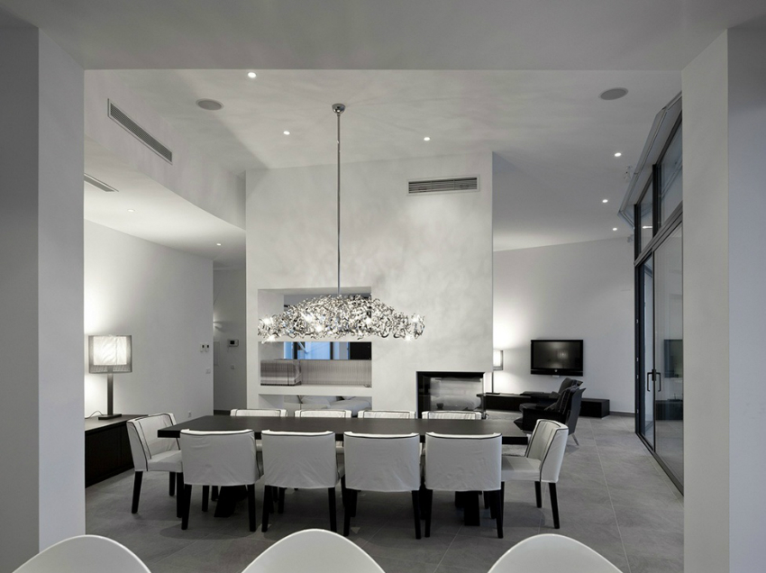 unusual-pendant-light-and-white-leather-dining-chairs-design-feat-rectangular-black-table-idea