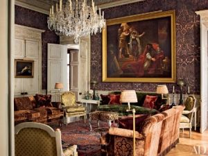 Businessman Pierre Bergé enlisted Roberto Peregalli and Laura Sartori Rimini of the design firm Studio Peregalli to transform the upper level of his Paris apartment. In the main salon, a bespoke damask-pattern canvas wall covering serves as the backdrop for a large painting by Antoine-Jean Gros.