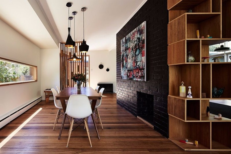 dark-accent-brick-wall-fashions-a-dramatic-focal-point-inside-the-contemporary-dining-space brick wall 10 Audacious Dining Rooms with Brick Walls Dark accent brick wall fashions a dramatic focal point inside the contemporary dining space