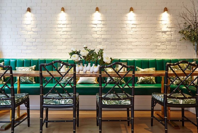 lighting-highlights-the-beauty-of-the-painted-brick-wall-in-the-dining-room brick wall 10 Audacious Dining Rooms with Brick Walls Lighting highlights the beauty of the painted brick wall in the dining room