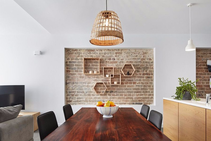 lovely-recessed-brick-wall-in-the-dining-room-with-geometric-wooden-shelves brick wall 10 Audacious Dining Rooms with Brick Walls Lovely recessed brick wall in the dining room with geometric wooden shelves