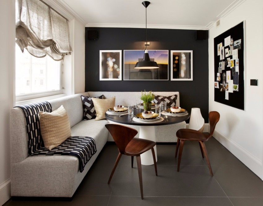 black accent wall 10 Black Accent Walls Dining Rooms apartment dining room ideas with transitional wall art