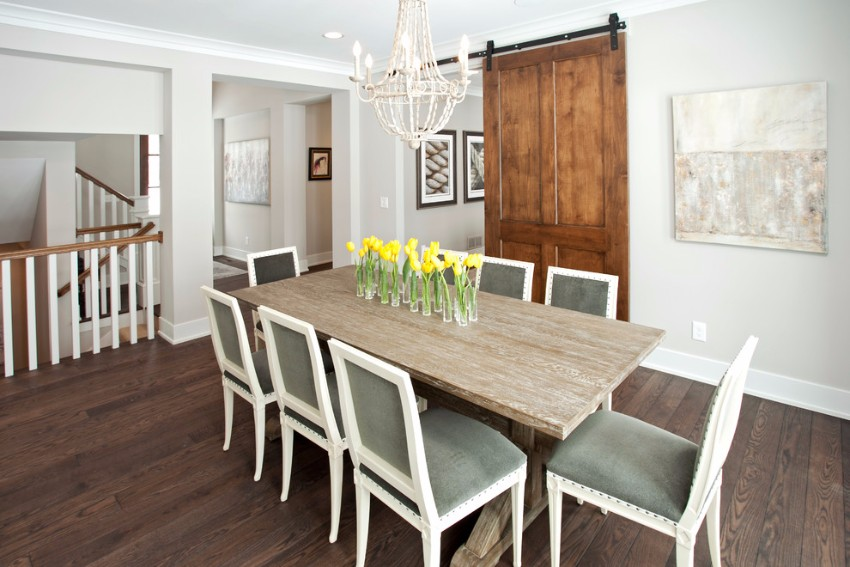 sliding doors 10 Marvelous Dining Rooms with Wooden Sliding Doors tulip arrangements Dining Room Transitional with artwork barn door chandelier dark stained wood