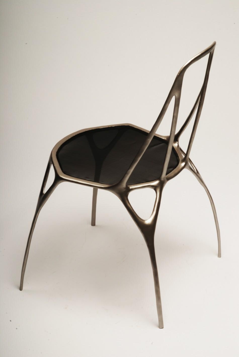 Benjamin Nordsmark Created Art From Modern Dining Chairs | www.bocadolobo.com #diningchairs #artisticchairs #artfurniture #thediningroom #diningarea #diningdesign #moderndiningtable @moderndiningtable