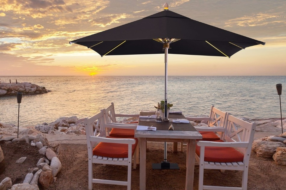The Illuminated Parasol You'll Need in Your Outdoor Dining Room | www.bocadolobo.com #diningroom #diningarea #thediningroom #outdoor #outdoordinner #diningtables #moderndiningtables #luxurybrands #exclusivedesign @moderndiningtables outdoor dining The Illuminated Parasol You'll Need in Your Outdoor Dining Room The Illuminated Parasol You   ll Need in Your Outdoor Dining Room 2